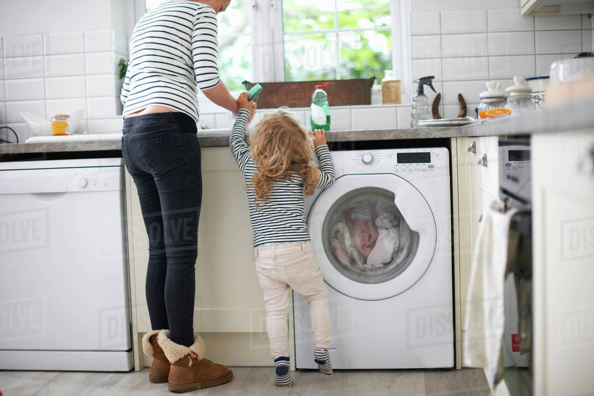 Beau Mother And Daughter In Kitchen, Daughter Helping Mum With Washing Up