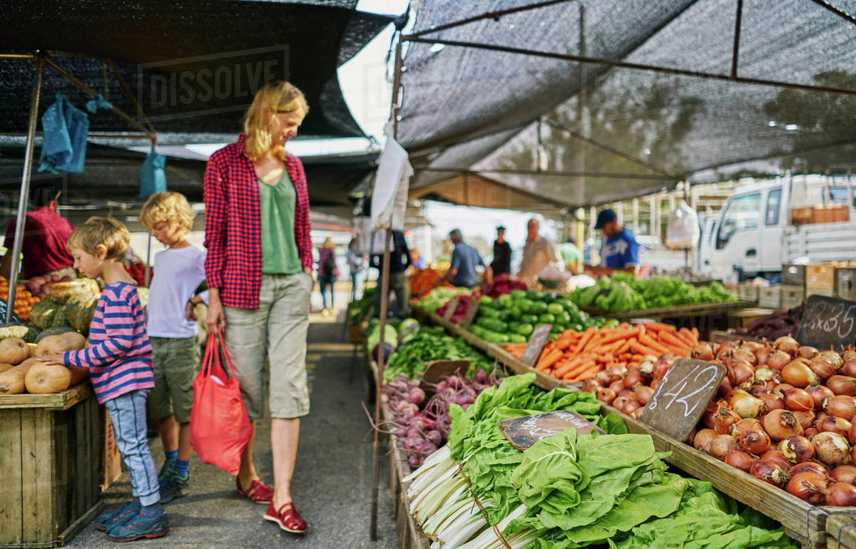 Mother and sons shopping at fruit and veg stall at market, Montevideo,  Uruguay, South America stock photo