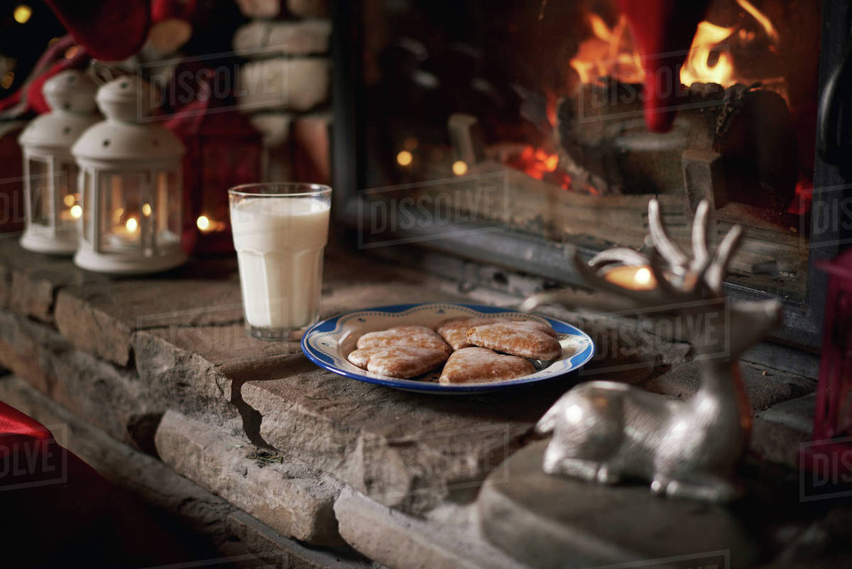 Cookies And Milk For Santa Left Beside Fireplace Stock Photo