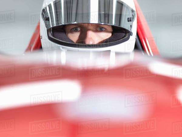 Close up portrait of racing car driver wearing helmet in supercar Royalty-free stock photo