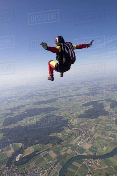 Female skydiver free falling over Grenchen, Berne, Switzerland Royalty-free stock photo
