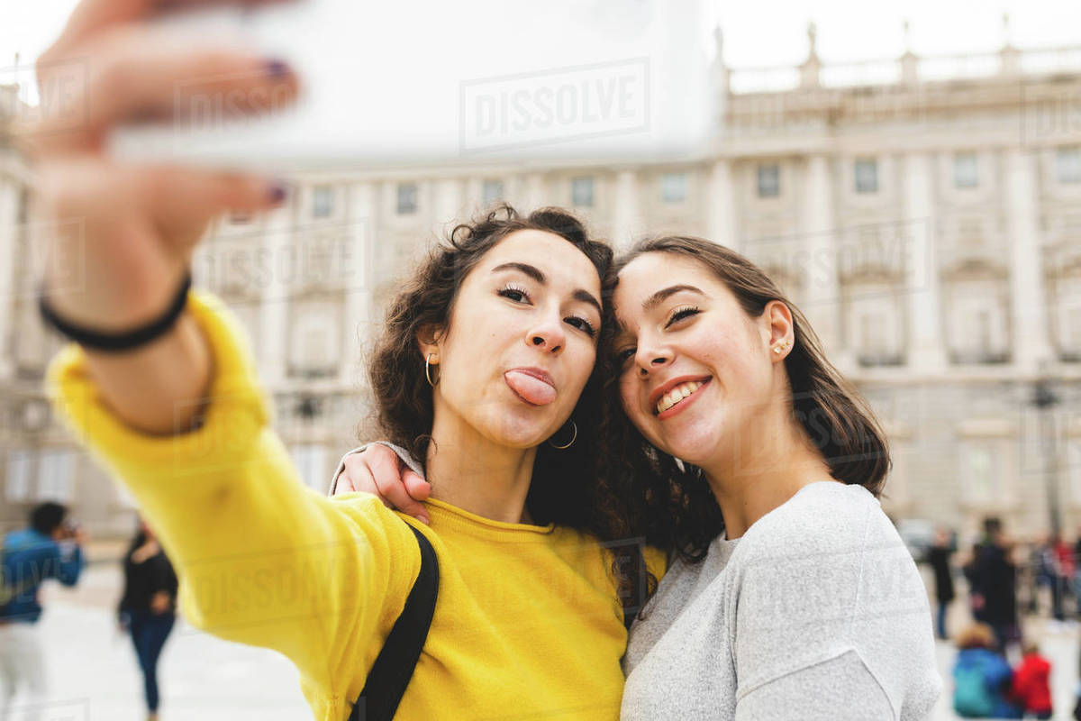 Girlfriends taking selfie in city, Madrid, Spain Royalty-free stock photo