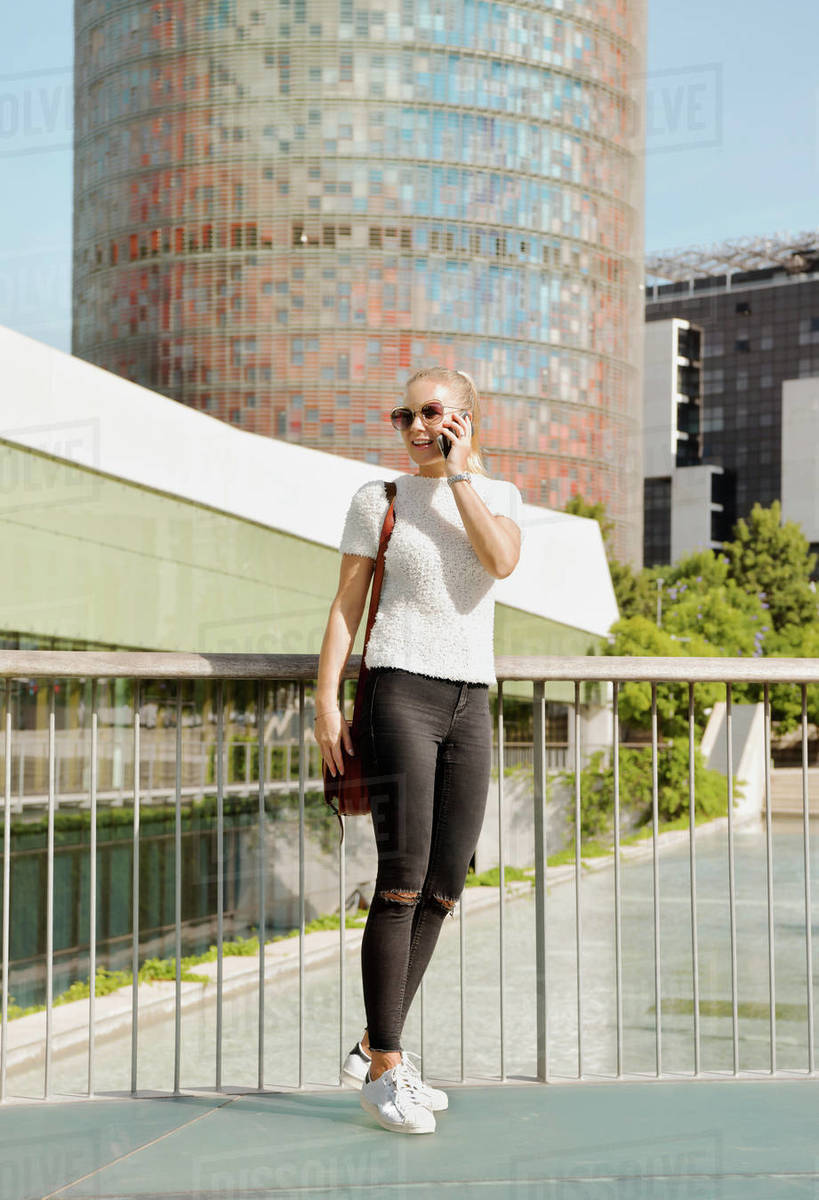 Woman using smartphone in city, Barcelona, Catalonia, Spain Royalty-free stock photo
