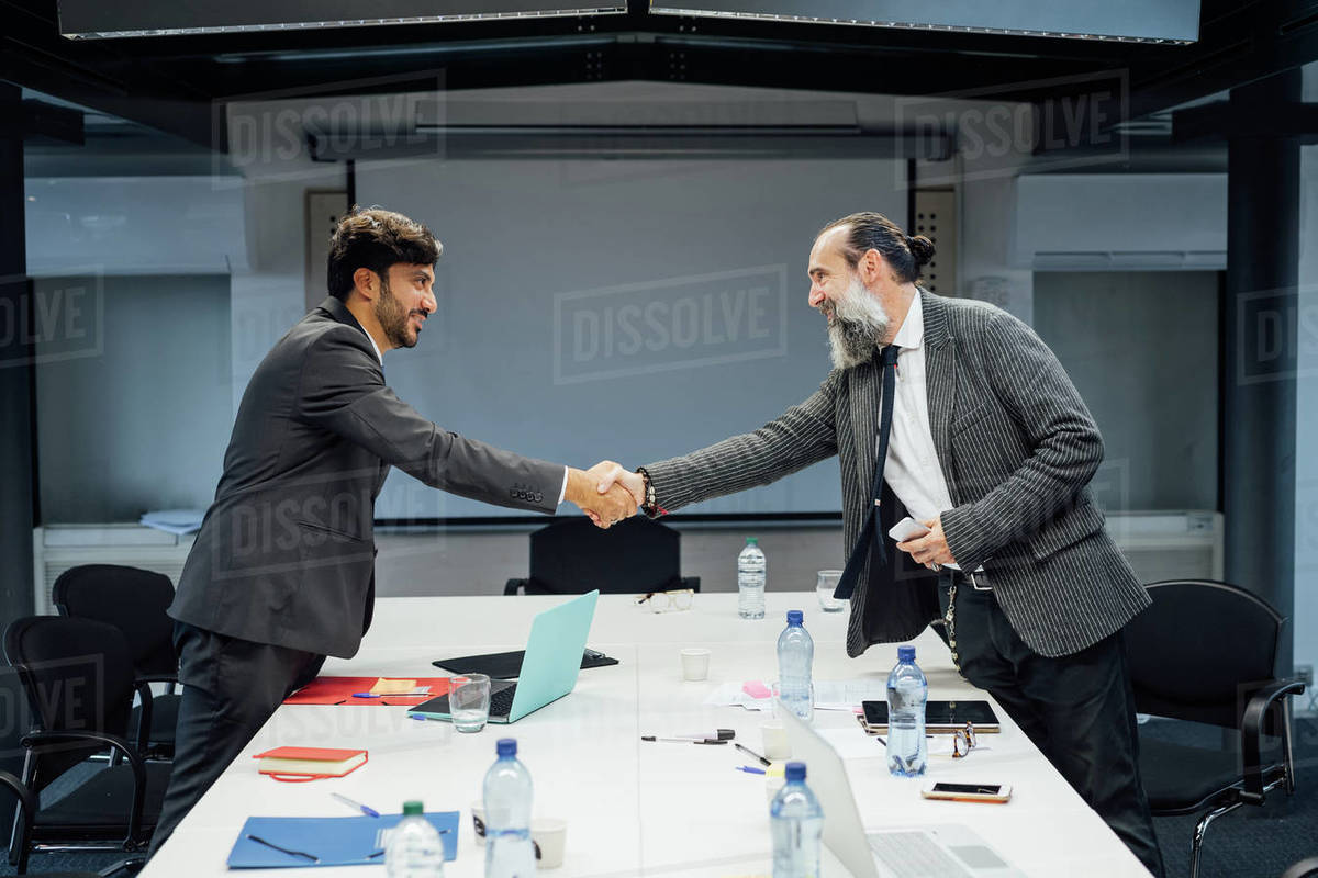 Business partners shaking hands at meeting in office Royalty-free stock photo