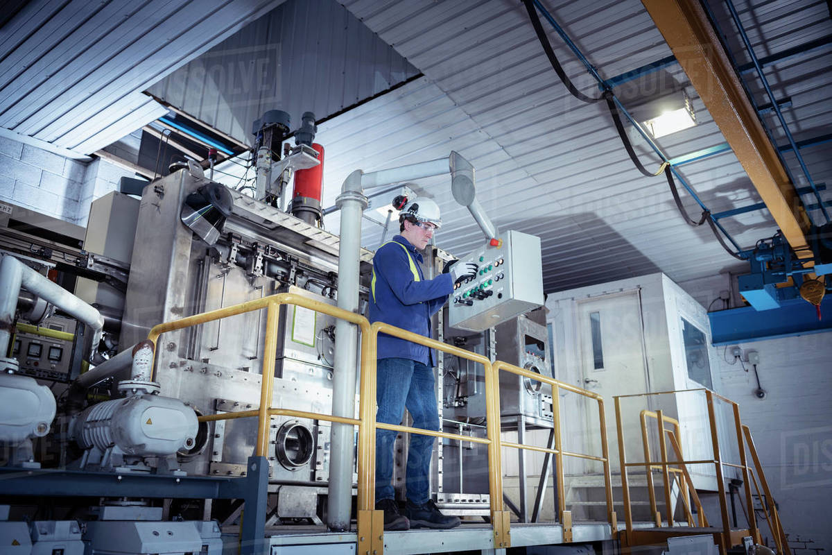 Worker with furnace equipment in titanium recycling plant Royalty-free stock photo