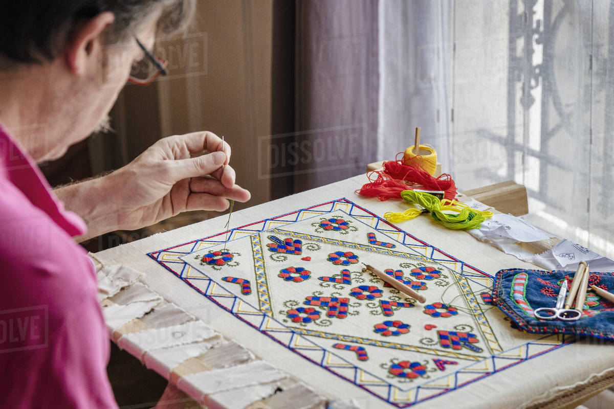 Craftsman busy with needlework indoors, Île-de-France, Paris Royalty-free stock photo