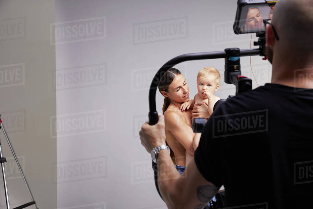 Photographer taking portrait of mother and baby Royalty-free stock photo