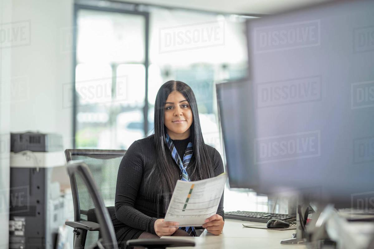 Portrait of female apprentice service advisor in car dealership Royalty-free stock photo