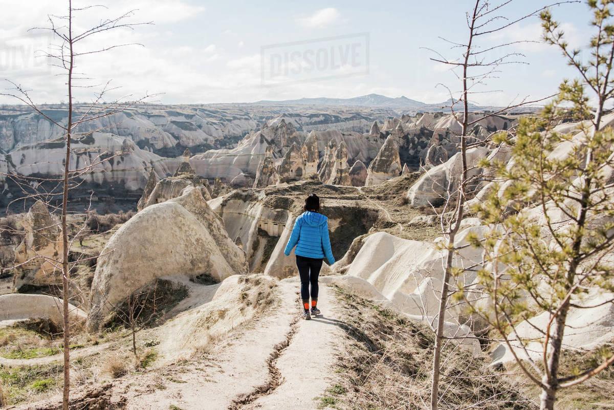 Woman hiking in rocky valley, Göreme, Cappadocia, Nevsehir, Turkey Royalty-free stock photo