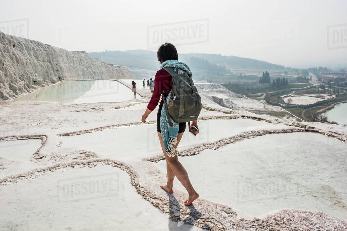 Woman walking across thermal pools, Pamukkale, Denizli, Turkey  Royalty-free stock photo