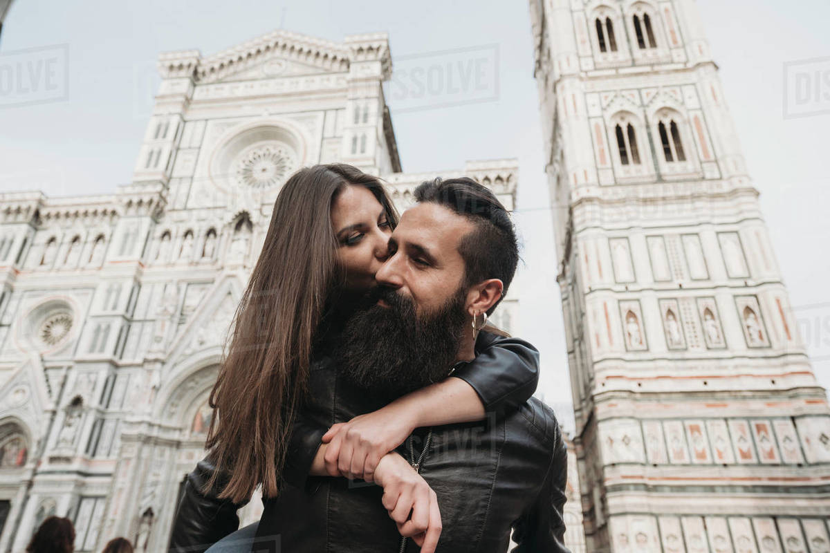 Couple playing piggyback ride and kissing, Santa Maria del Fiore, Firenze, Toscana, Italy Royalty-free stock photo