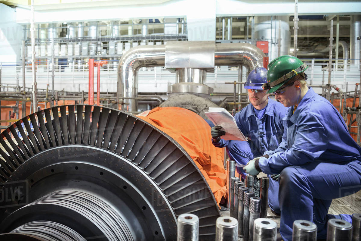 Engineer inspecting a turbine in a  nuclear power station. Royalty-free stock photo