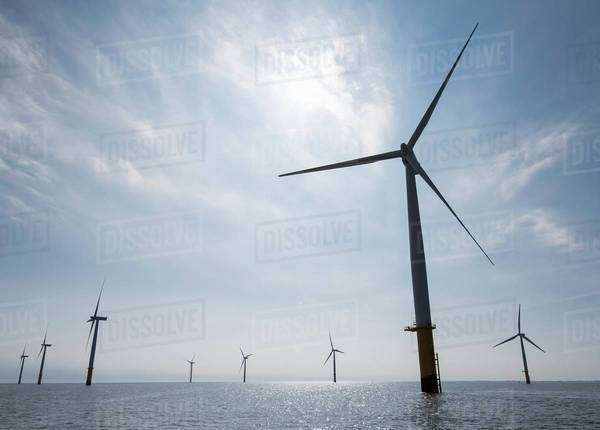 View of silhouetted offshore windfarm from service boat Royalty-free stock photo