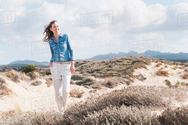 Mid adult woman strolling in sand dunes, Sardinia, Italy Royalty-free stock photo