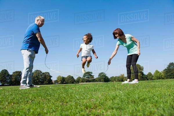 Older couple playing with granddaughter Royalty-free stock photo