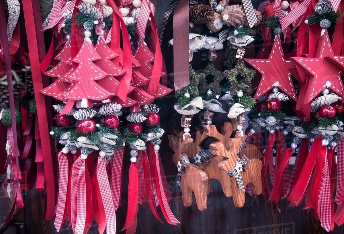 Close up of red wooden xmas decorations on German Christmas market stall