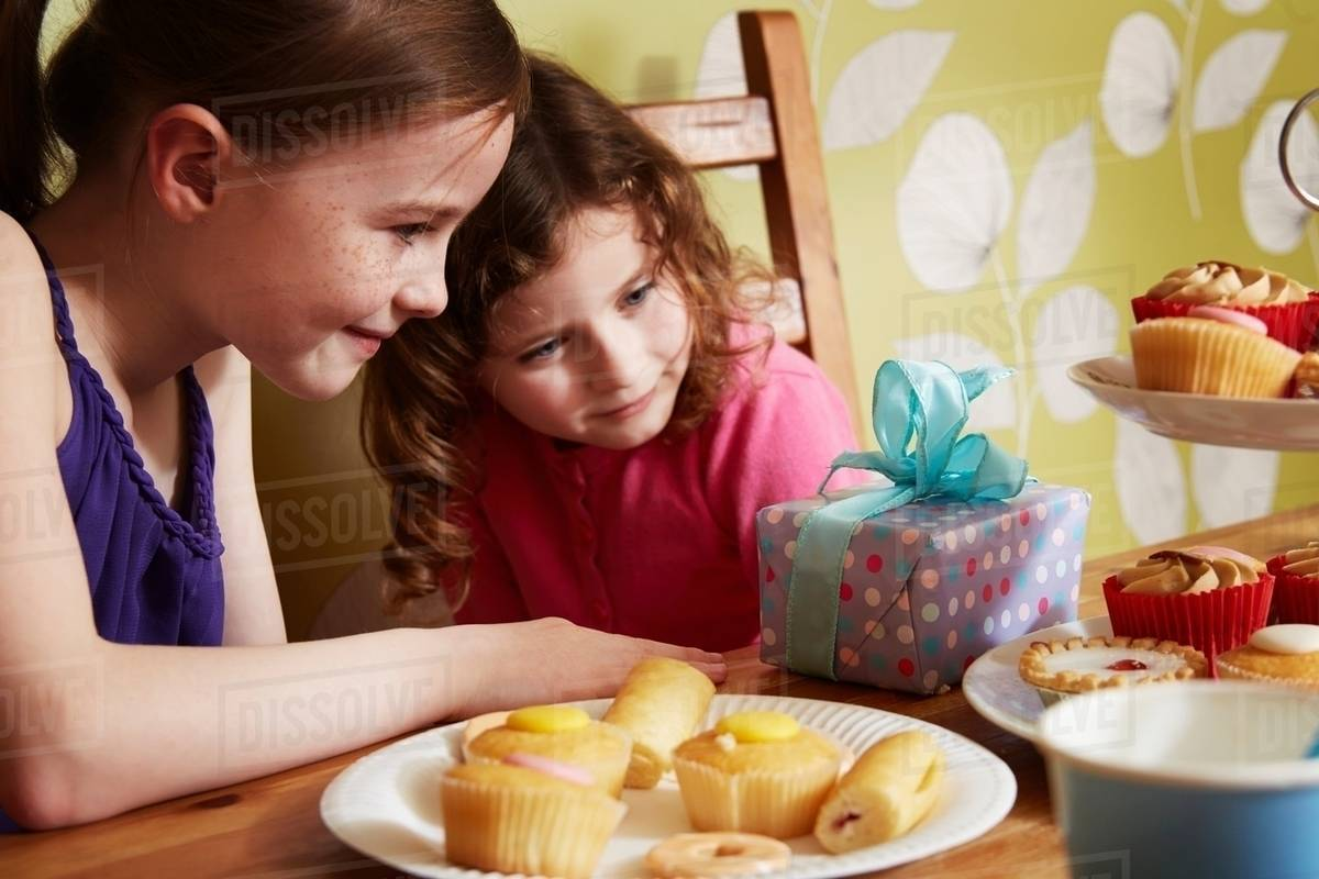 Outstanding Two Girls Looking At Birthday Present With Plate Of Cakes Stock Funny Birthday Cards Online Drosicarndamsfinfo