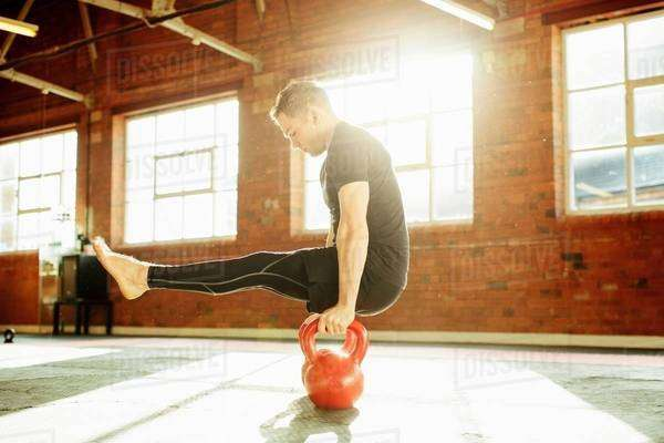 Man strength training with kettle bells Royalty-free stock photo