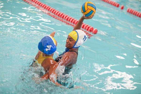 Girls playing water polo Royalty-free stock photo