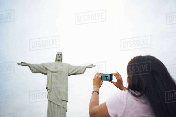 Mature woman photographing Christ the Redeemer, Rio De Janeiro, Brazil Royalty-free stock photo