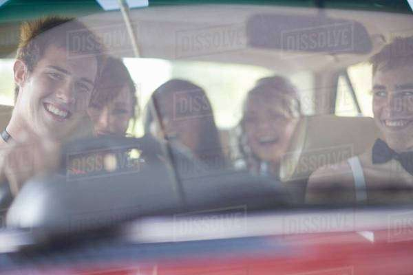 Teenagers driving in formal wear Royalty-free stock photo