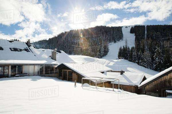 Snow holiday chalets in front of ski slope, Tyrol, Austria Royalty-free stock photo