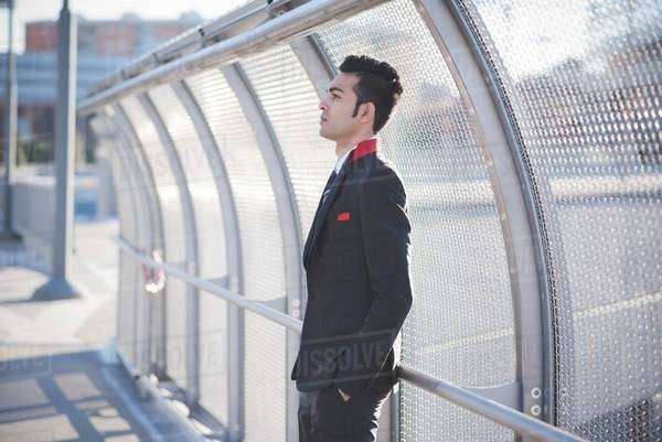 Young businessman by bridge safety fence Royalty-free stock photo