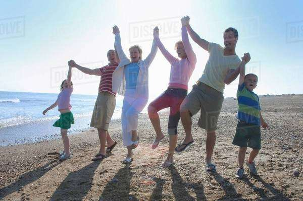 Family holding hands on beach Royalty-free stock photo