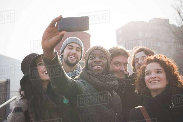 Six young adult friends taking smartphone selfie Royalty-free stock photo