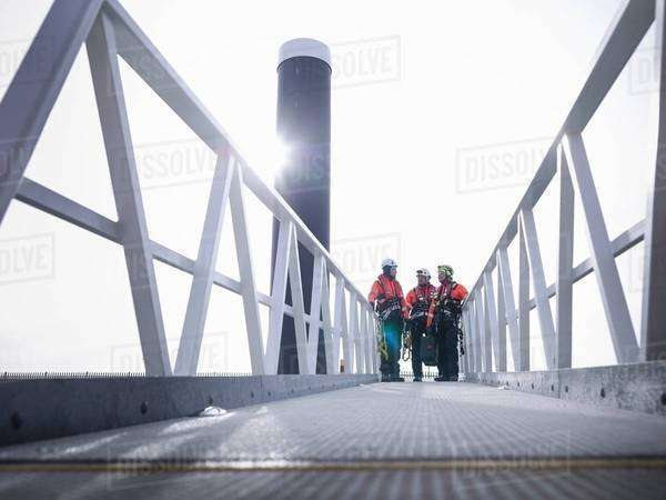 Offshore windfarm engineers in port on walkway Royalty-free stock photo