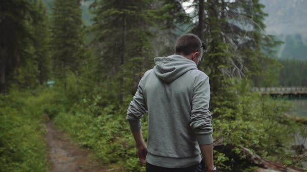 Slow motion shot view of a man walking alone in the woods Royalty-free stock video