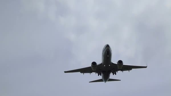 Commercial passenger airplane flying overhead on sunny day. Royalty-free stock video