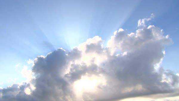 Beautiful cloudscape with large, building clouds and sunrise breaking through cloud mass. Royalty-free stock video