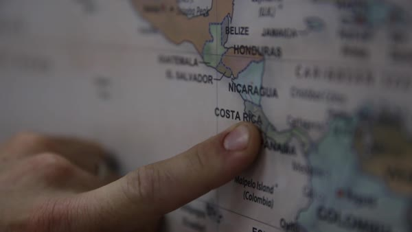 Fingers tracing on a world map stock video footage dissolve fingers pointing to costa rica on world map royalty free stock video gumiabroncs Image collections