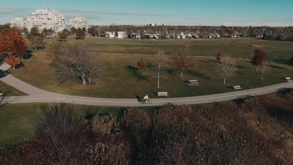 Aerial of man biking in fall Royalty-free stock video