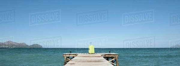Yellow suitcase at end of dock Royalty-free stock photo