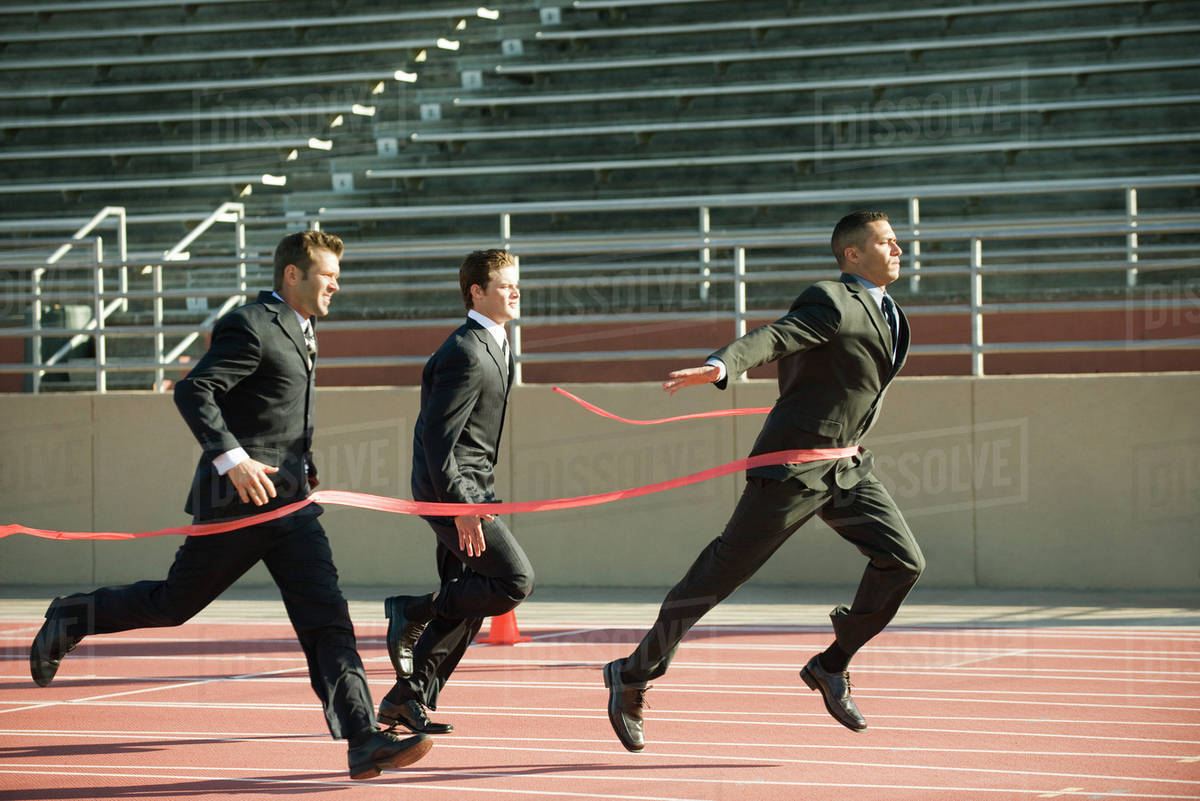 Finish Line Photography: Businessman Crossing Finish Line In Race