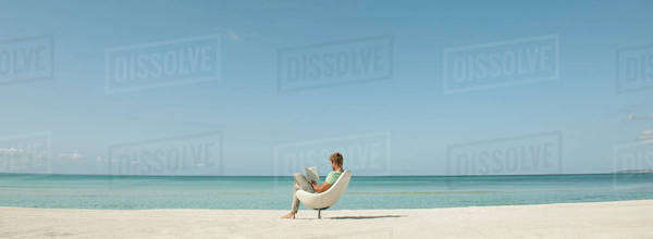 Man reading book at the beach Royalty-free stock photo