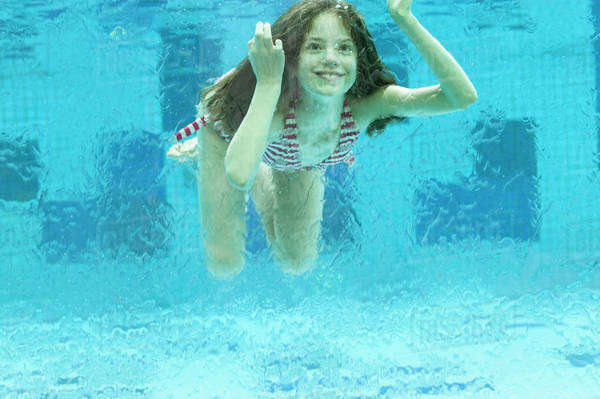 Girl Swimming Underwater In Swimming Pool - Stock Photo - Dissolve-7208