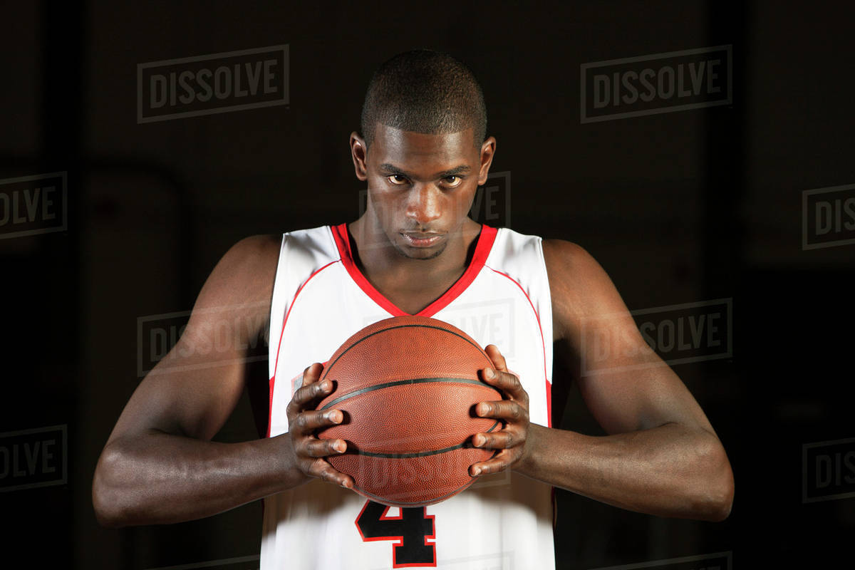 basketball player holding basketball portrait stock photo dissolve