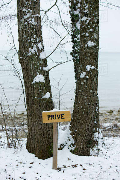 "Wintery scene with sign reading ""private"" in French Royalty-free stock photo"