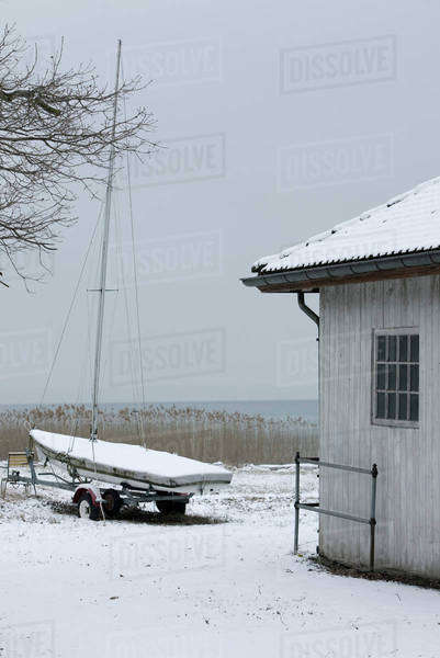 Sailboat ashore in wintery scene Royalty-free stock photo