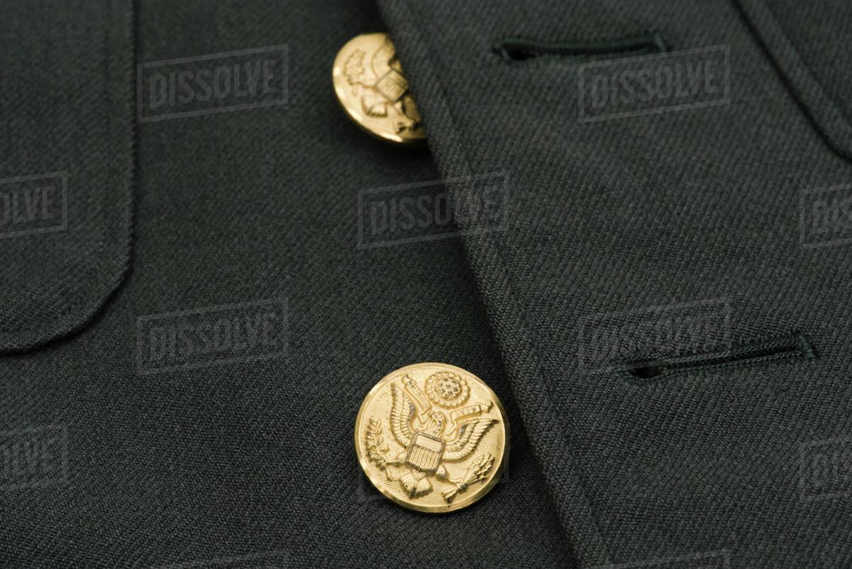 Brass buttons of military dress uniform jacket stock photo