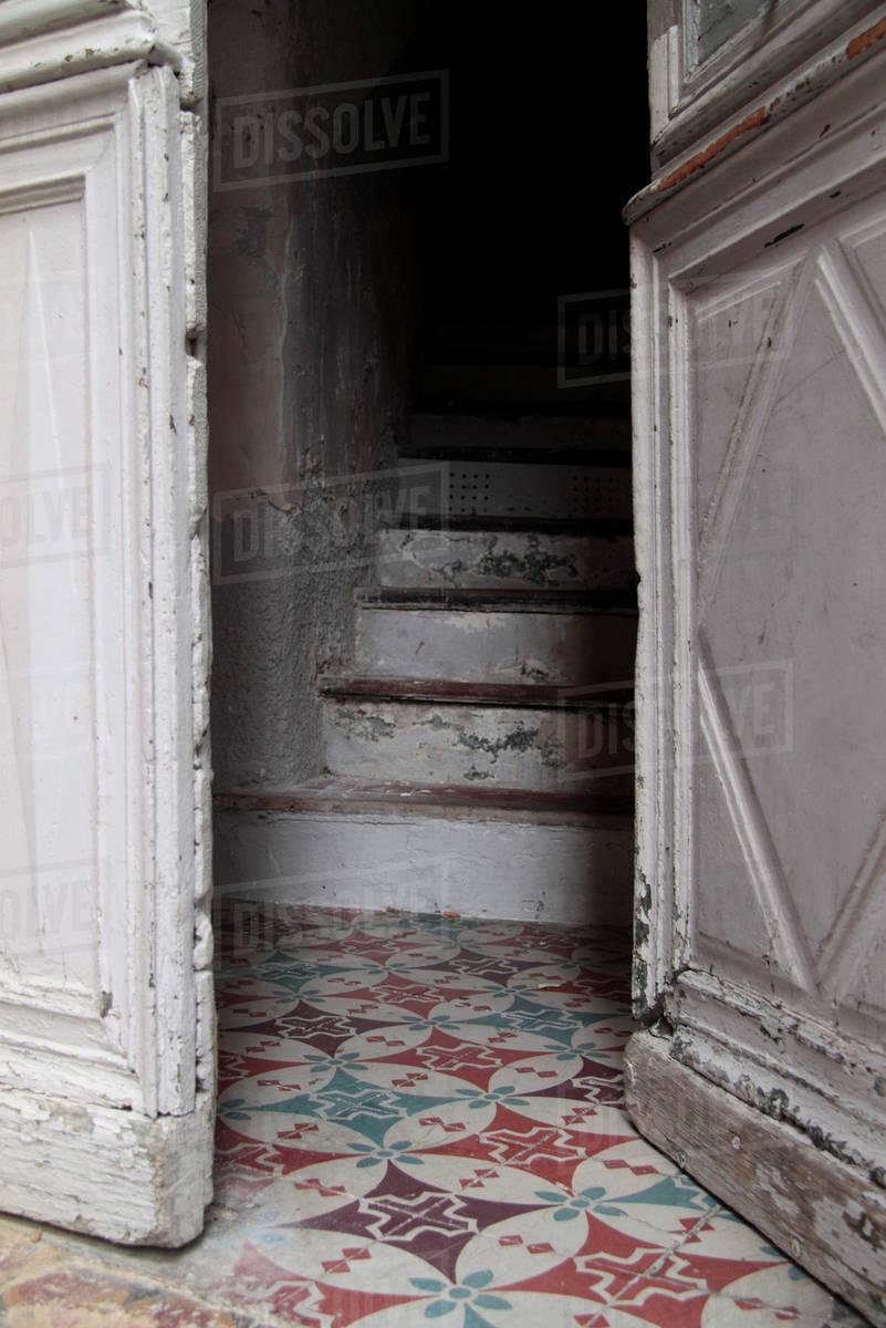 Half Open Door Leading To Stairway