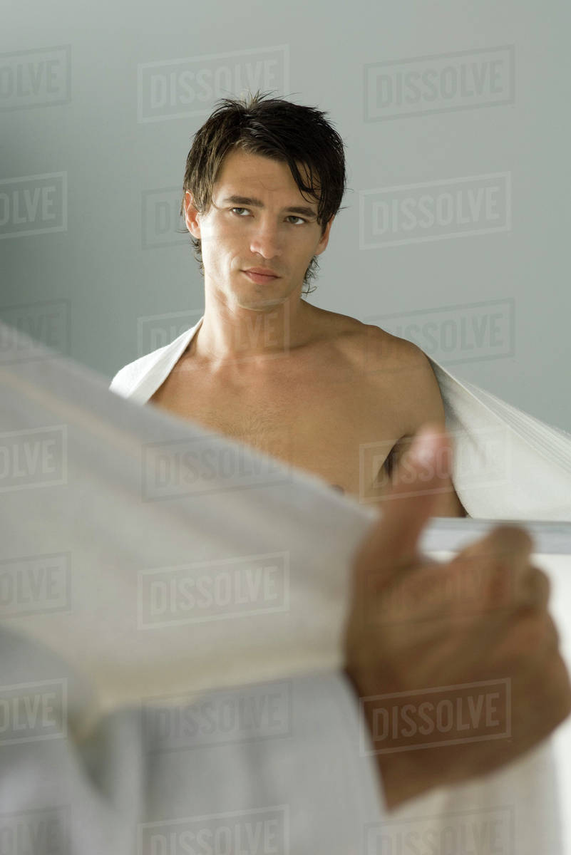 Man Looking At Self In Mirror Pulling Bathrobe Open Stock Photo Dissolve