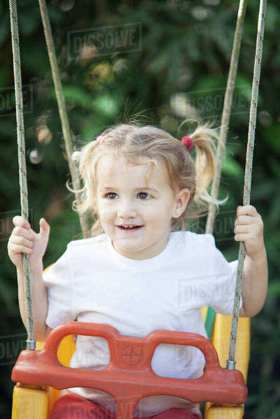 Little girl on swing Royalty-free stock photo