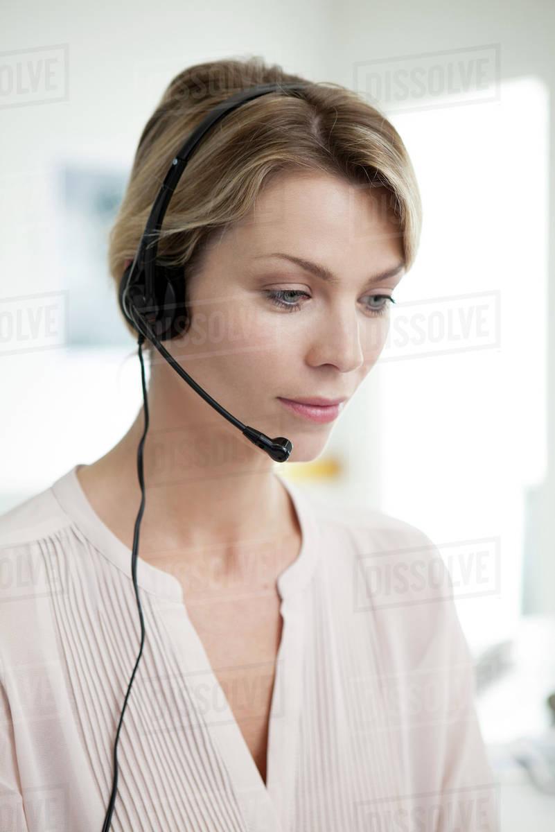 Office Worker Wearing Phone Headset Multitasking Stock Photo Dissolve