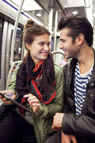 Young couple riding subway together Royalty-free stock photo