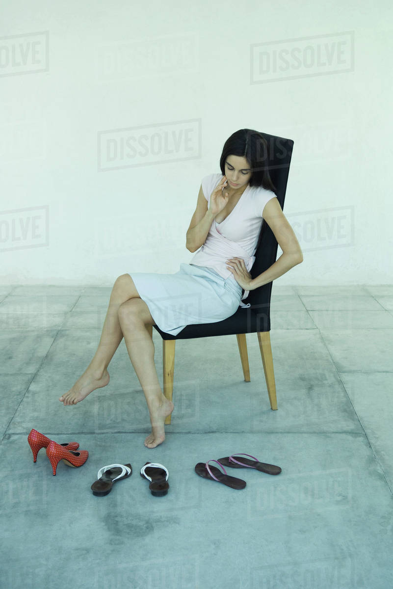 f510e39754 Young woman sitting in chair