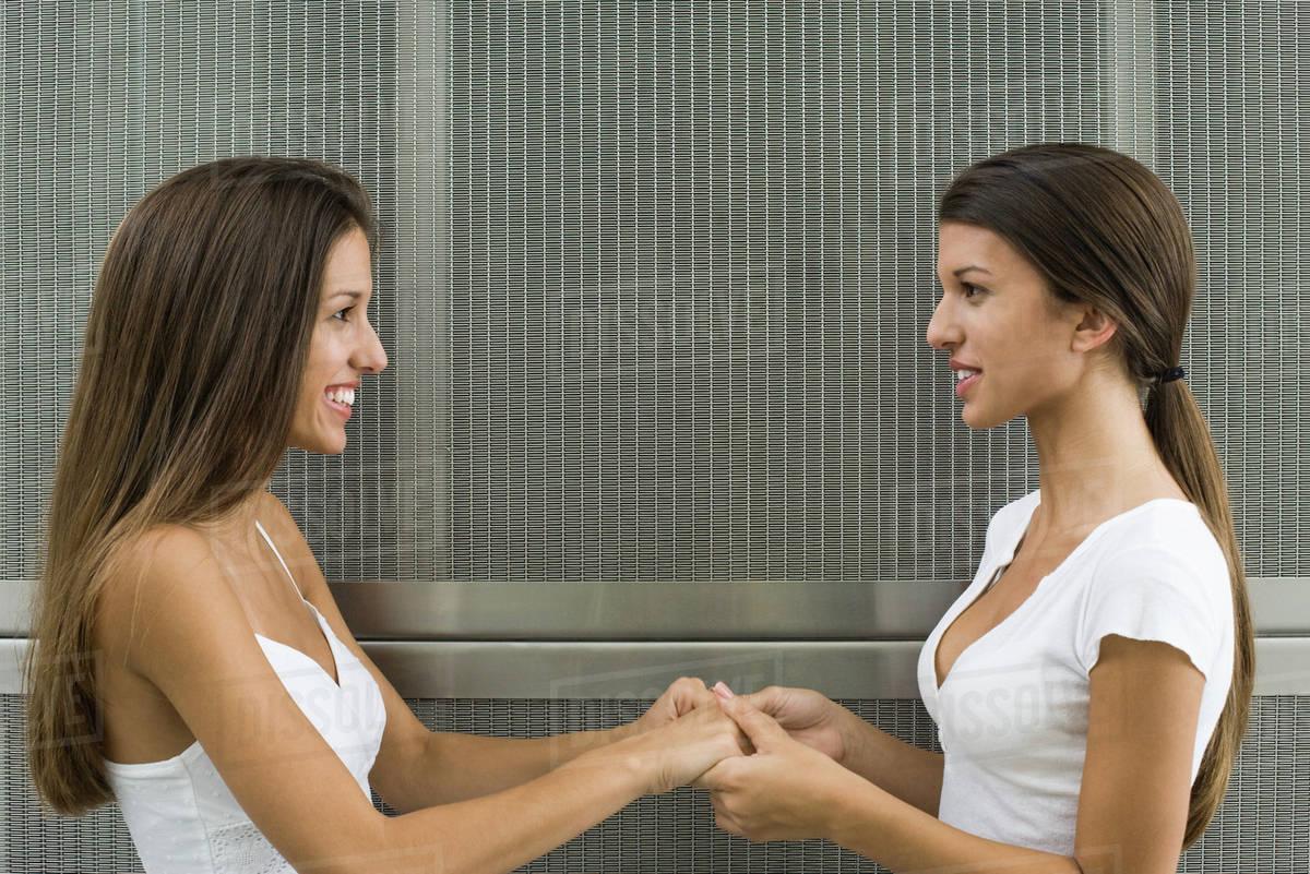 teenage-girls-holding-hands-ladies-squatting-squattingwomen